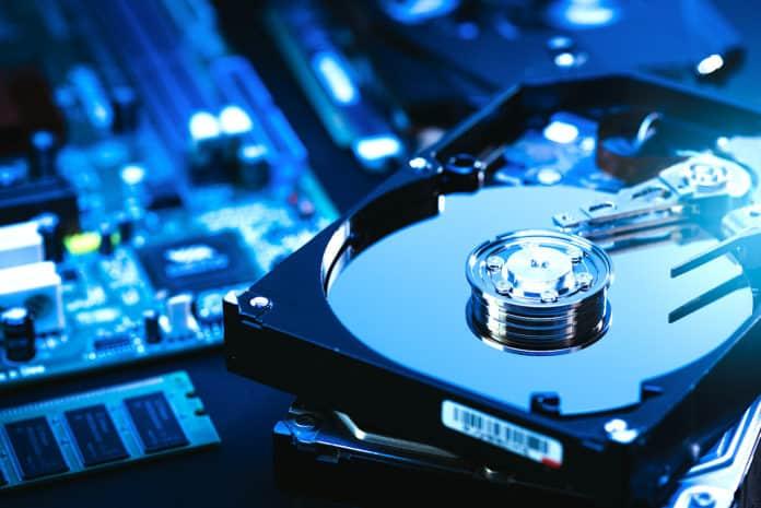 Hard disk drive resting against computer motherboard.
